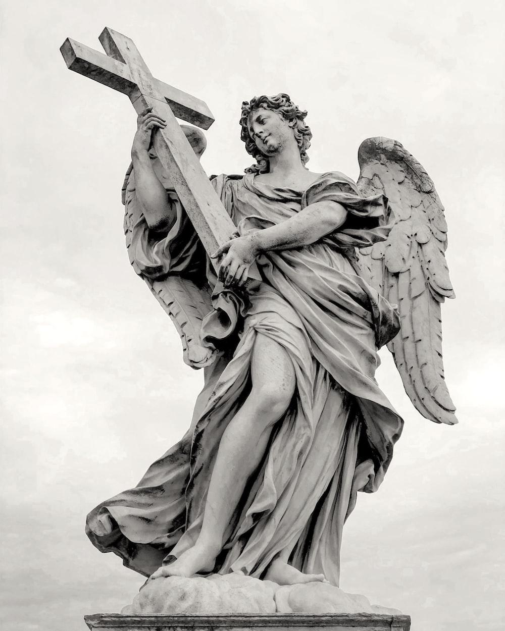 angel statue under white sky during daytime