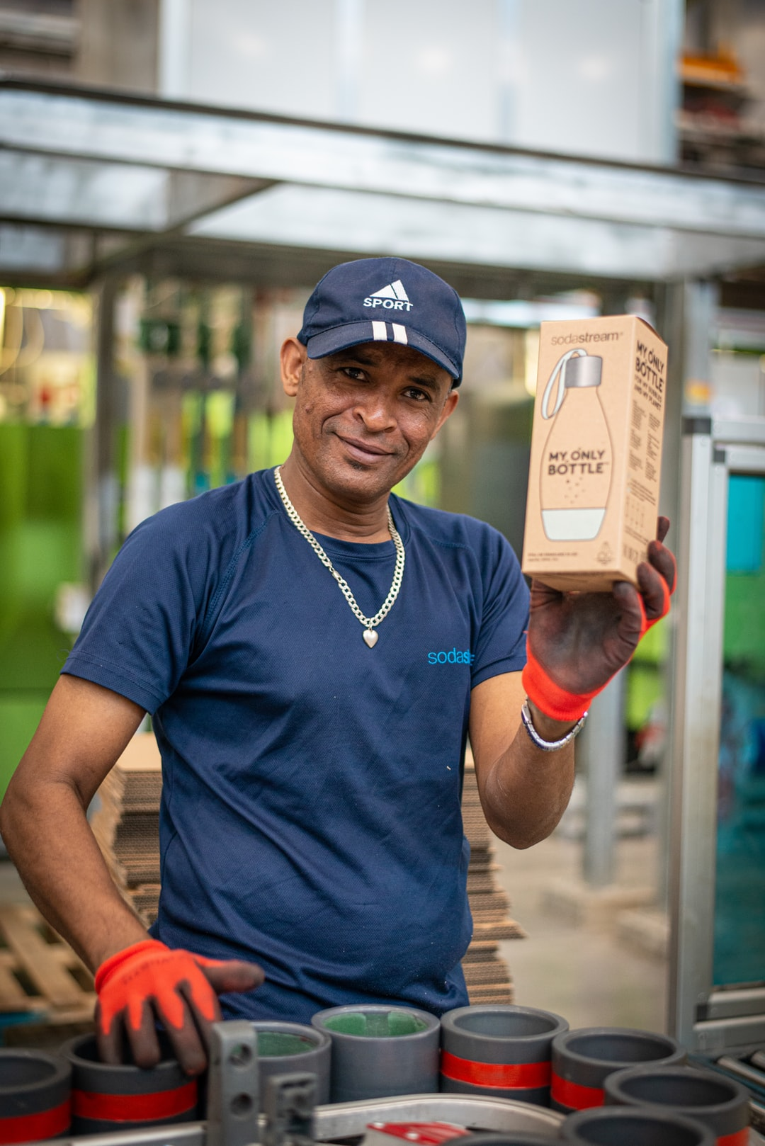 Man holding a box at the SodaStream factory in Israel. Shot during press trip to SodaStream factory in 2019.