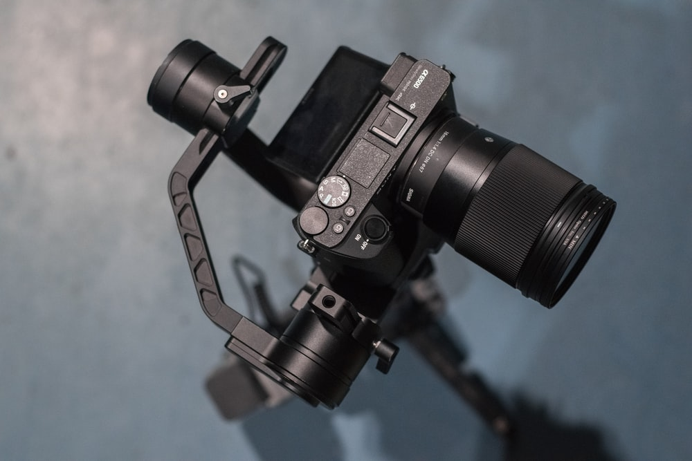 black dslr camera on tripod