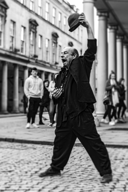 man in black coat walking on street