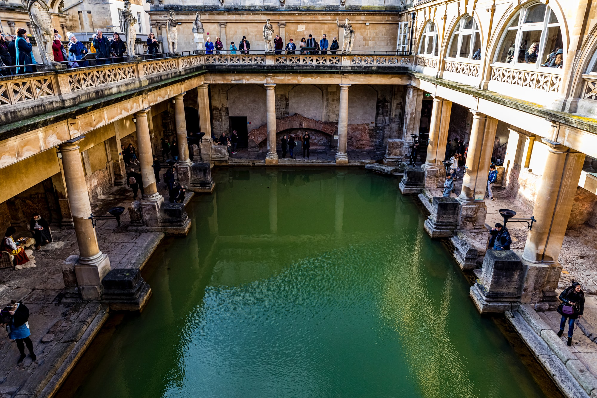 Antique historic landmark Roman Baths in Bath England UK, February 2020.