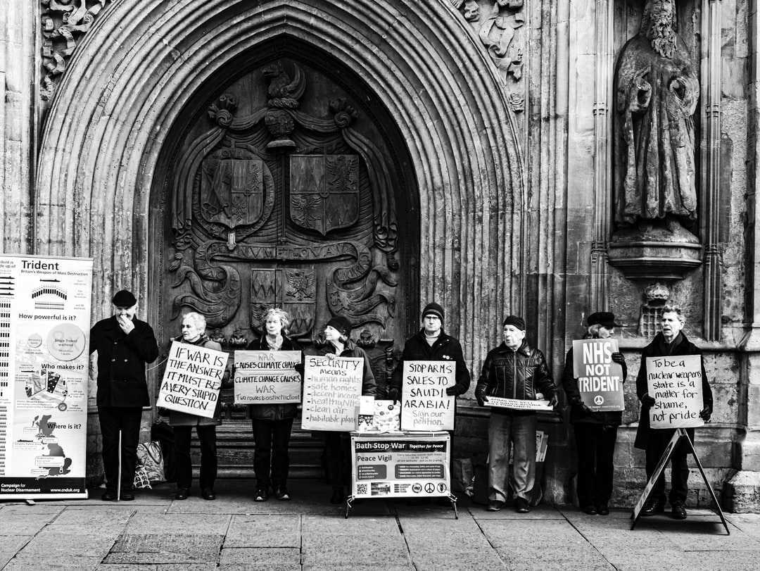 Anti-war, anti-nuclear, anti-armaments demostrators protestors lined up in front of Bath Abbey Bath England UK, February 2020.