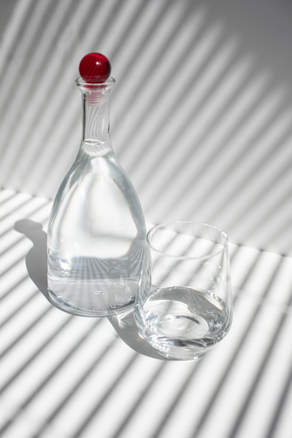 clear glass bottle with water