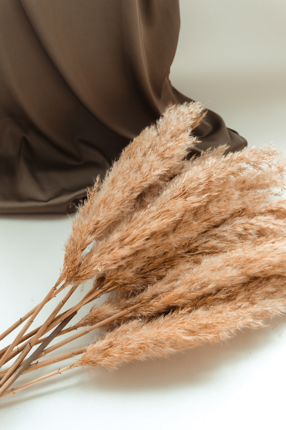 brown fur textile on black leather chair