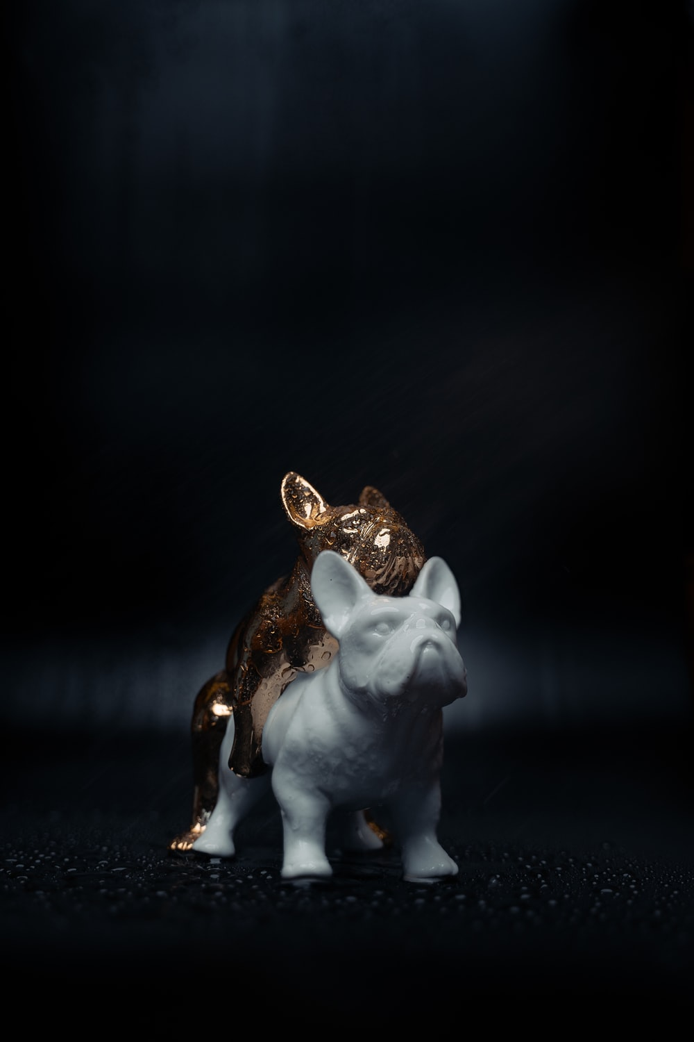 white and brown ceramic dog figurine