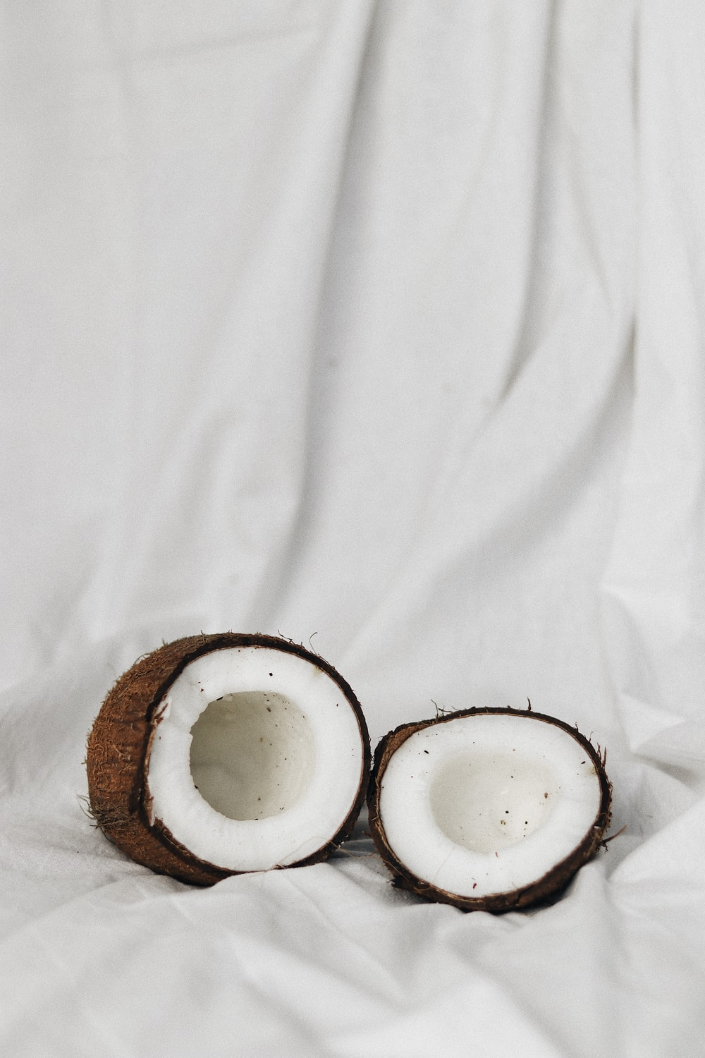 2 white ceramic bowls on brown wooden tray