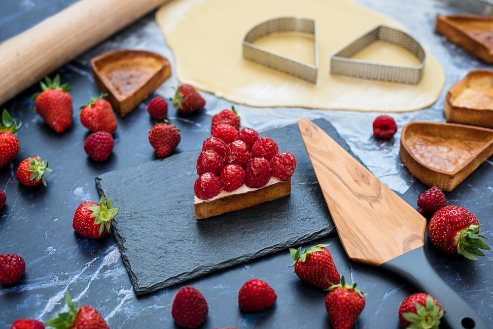 strawberries on brown wooden chopping board