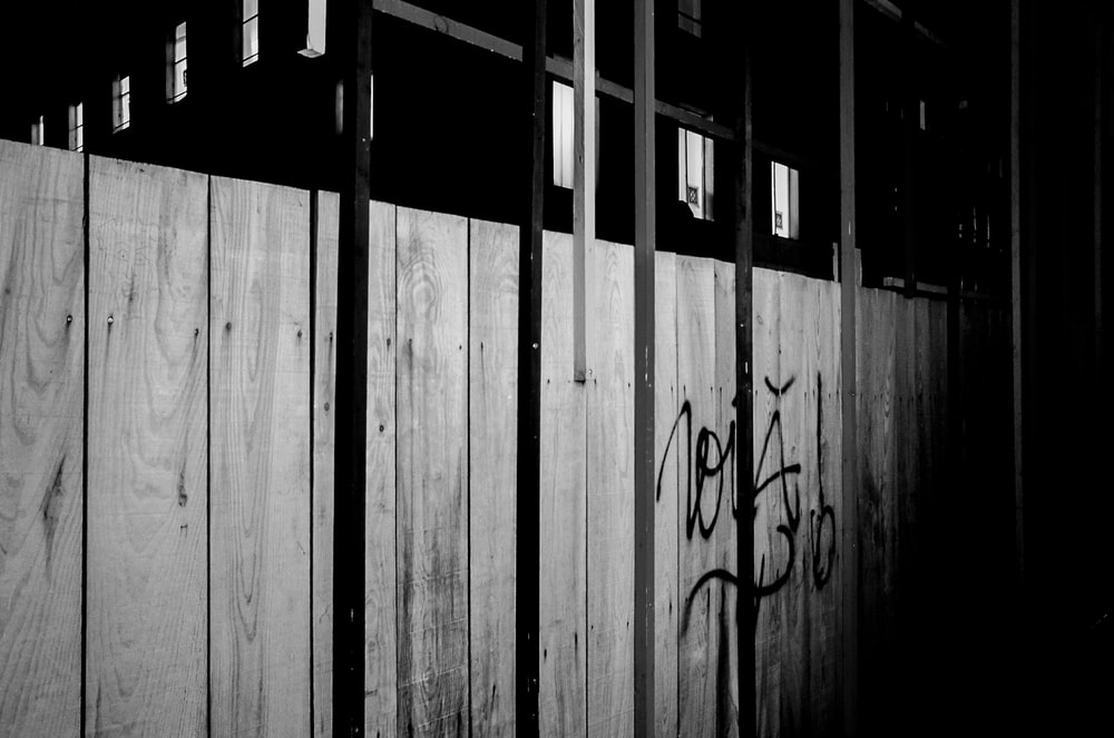 grayscale photo of wooden wall