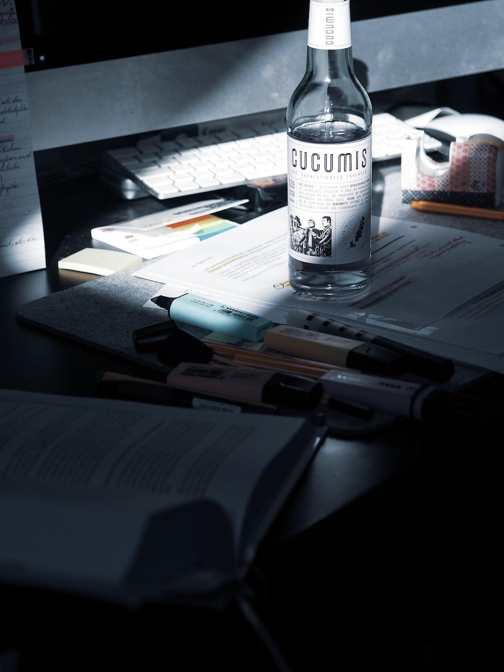clear plastic bottle on white printer paper