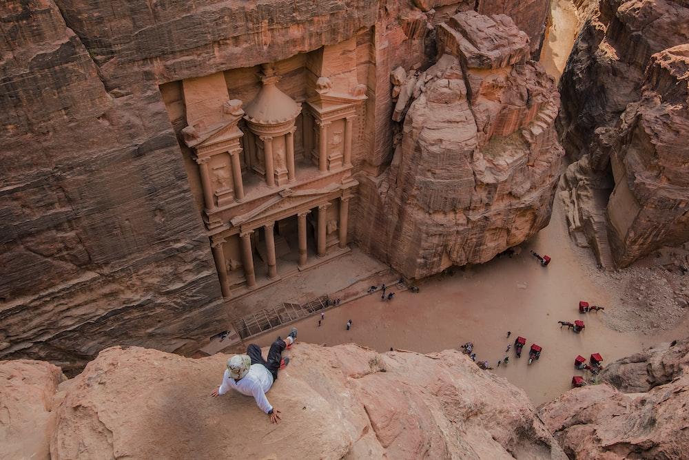 people walking on brown rocky mountain during daytime