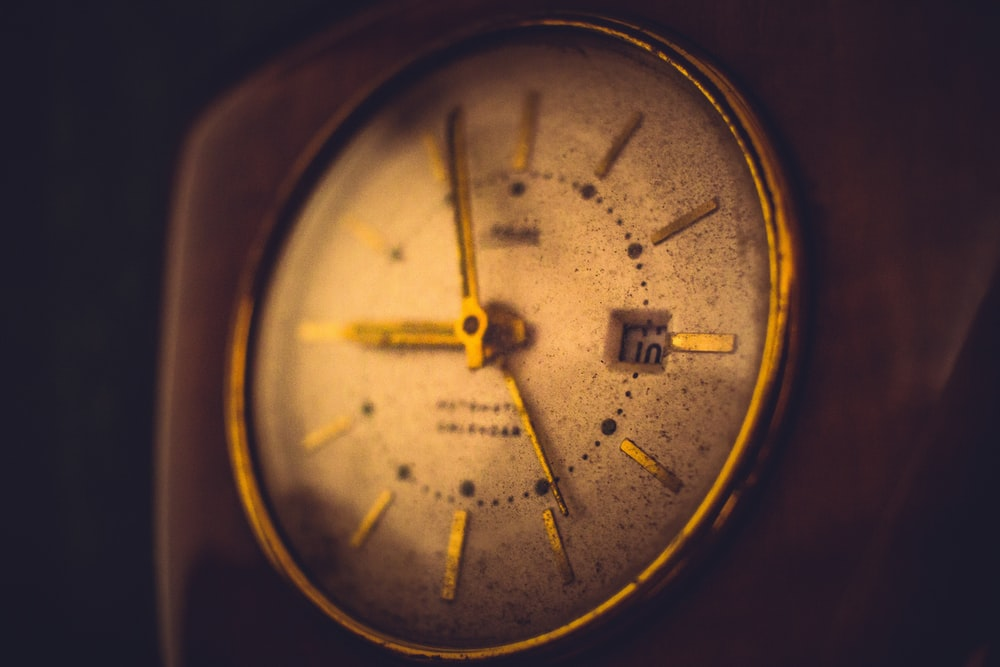 gold and white analog watch