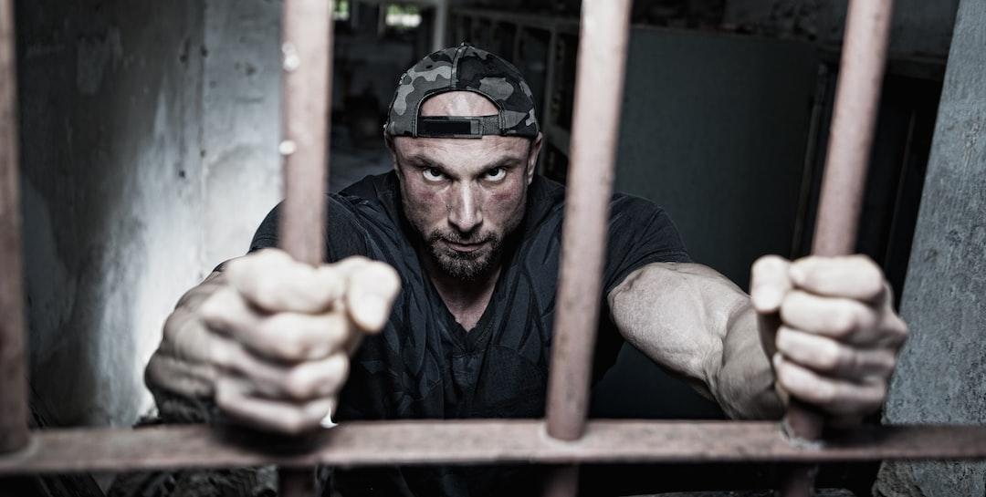 Inmate behind the bars