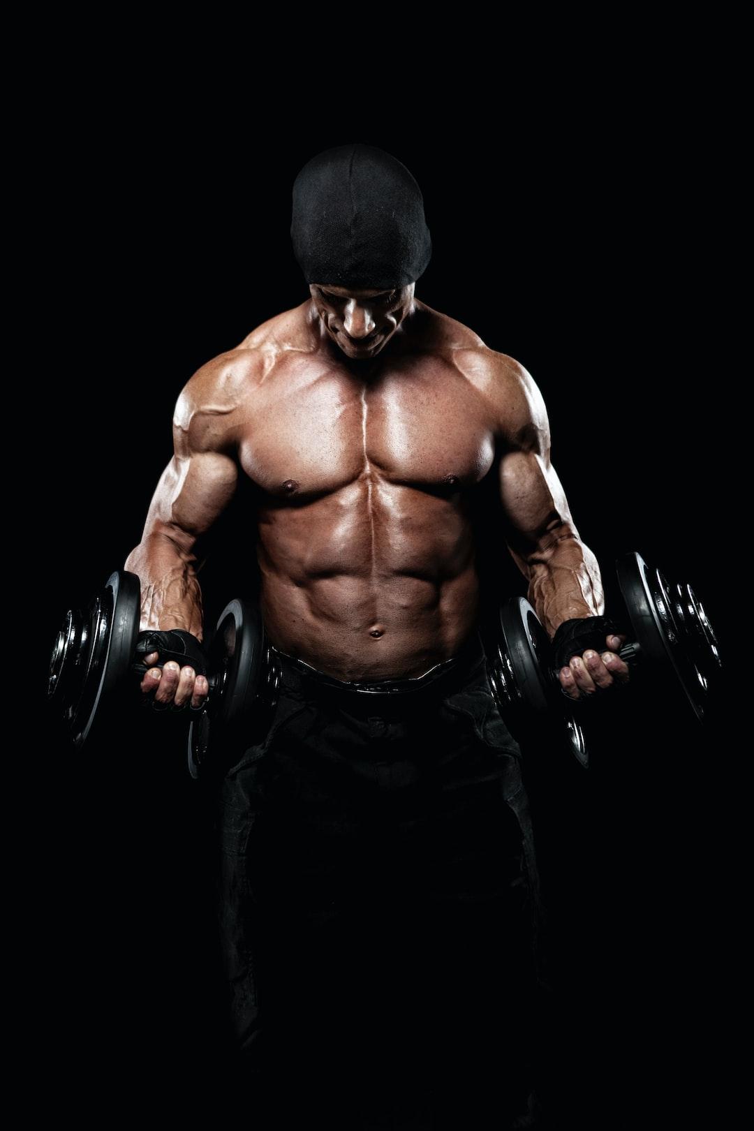 Muscular bodybuilder lifting dumbbells.
