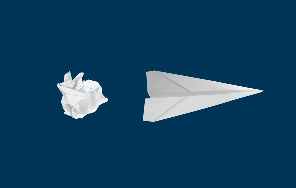 white paper plane on white background