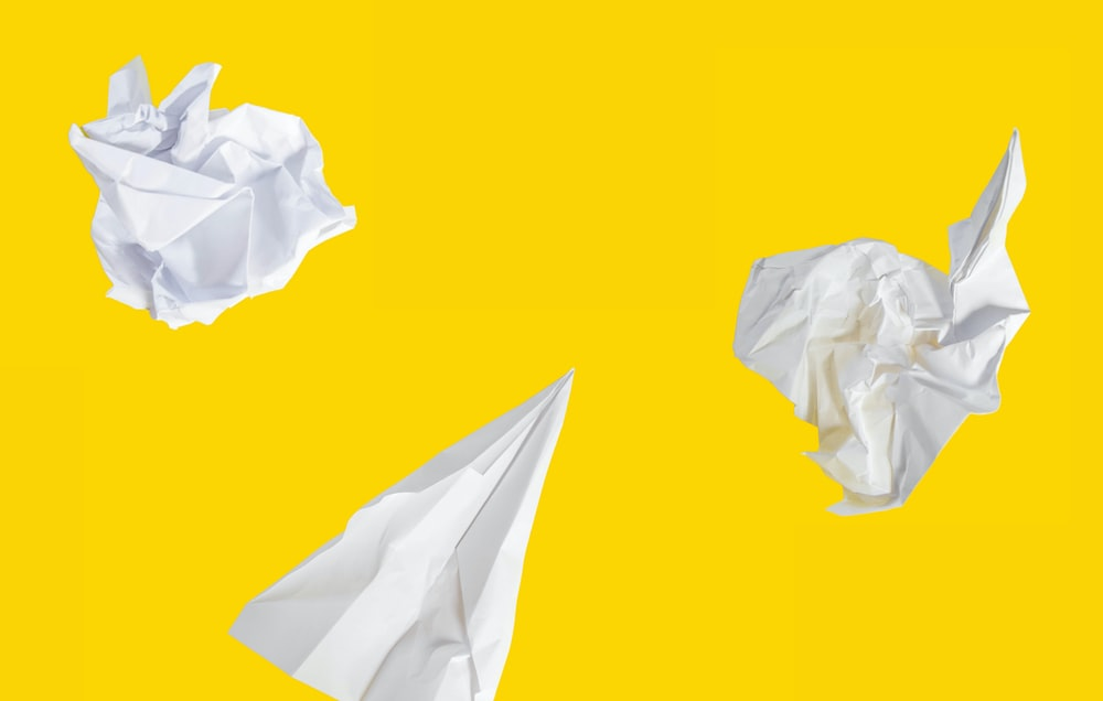 white paper on yellow background