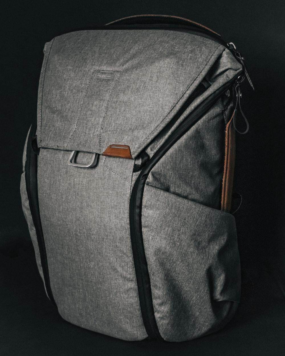 gray and black sling bag