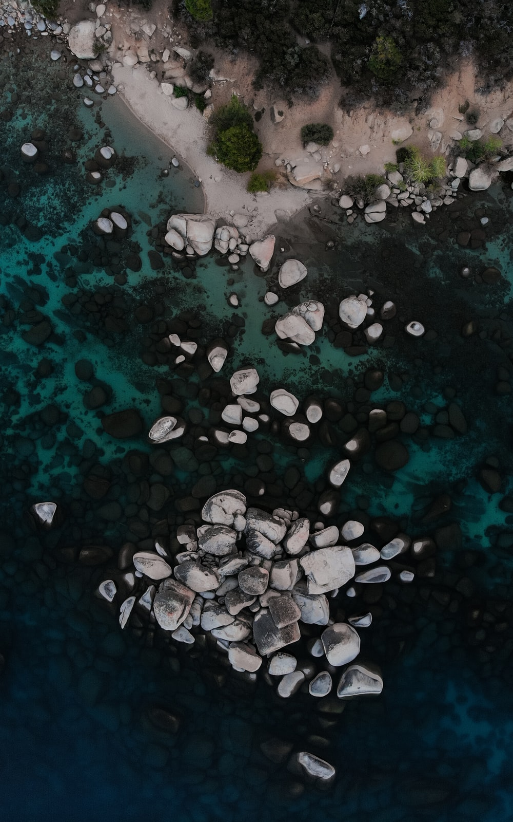 white and black stones on body of water