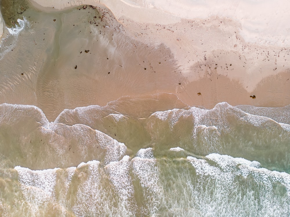 white and brown ocean waves