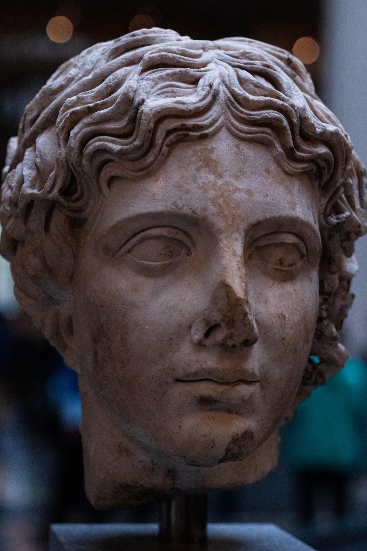 womans face concrete statue