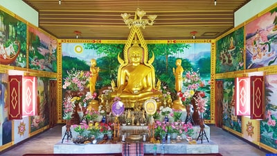 gold buddha statue on table buddhist temple zoom background