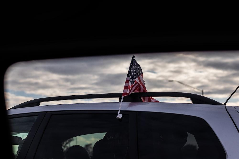 us a flag on car window