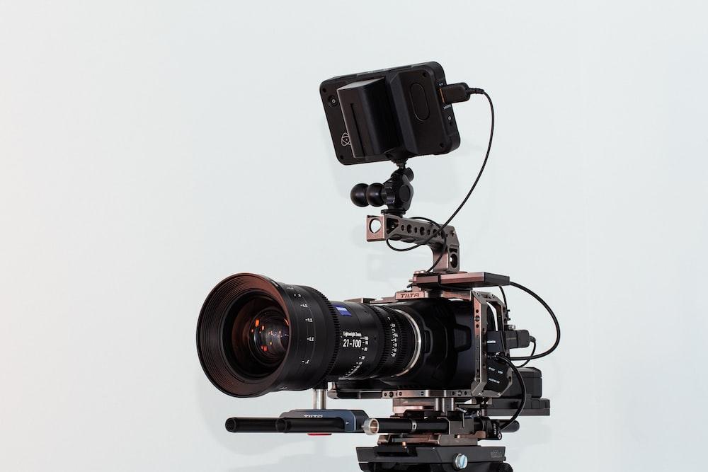 black dslr camera on white table
