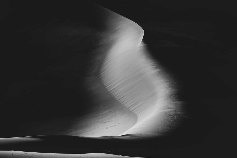 grayscale photo of water wave