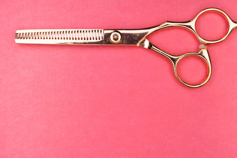 silver scissors on pink textile