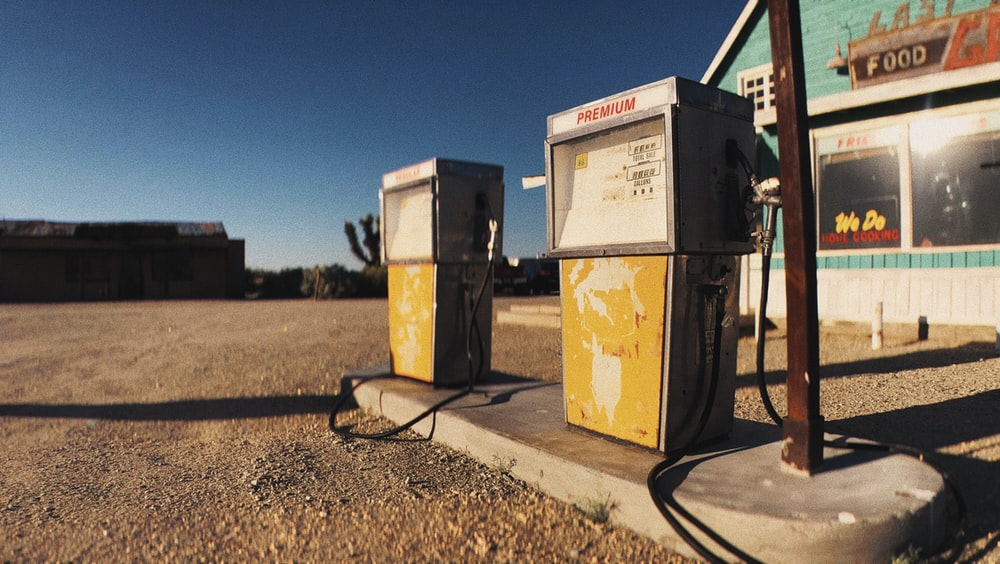 2 yellow and black gas dispenser