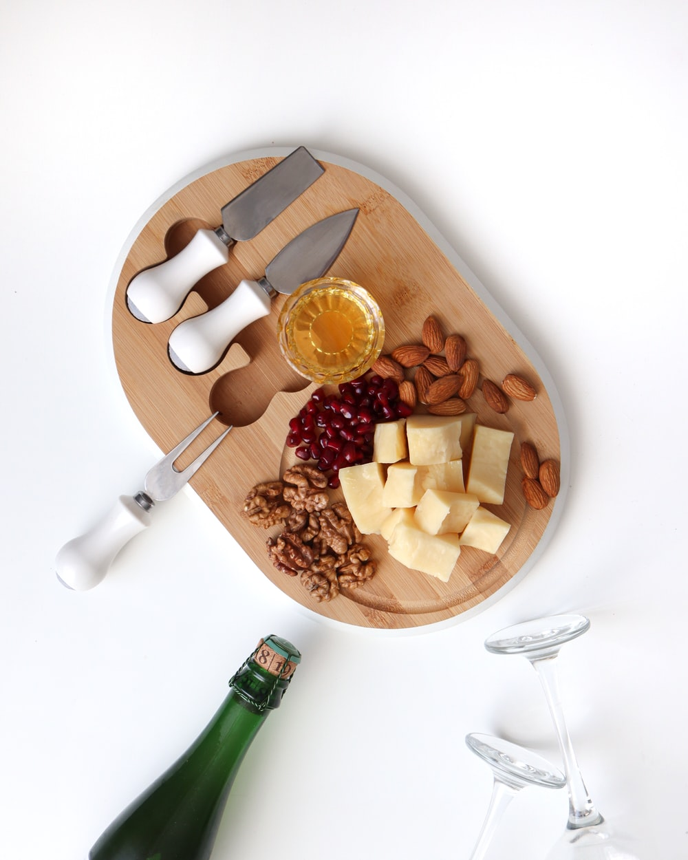 sliced apple and sliced apple on brown wooden chopping board