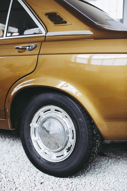 brown car with chrome wheel