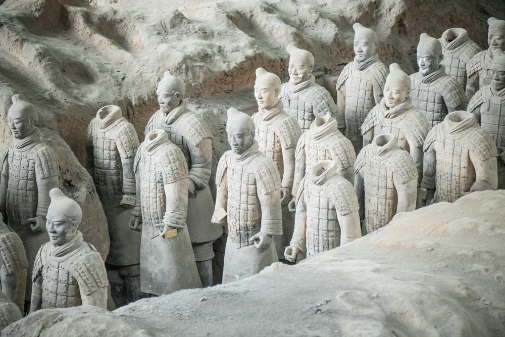 group of men in white robe statues