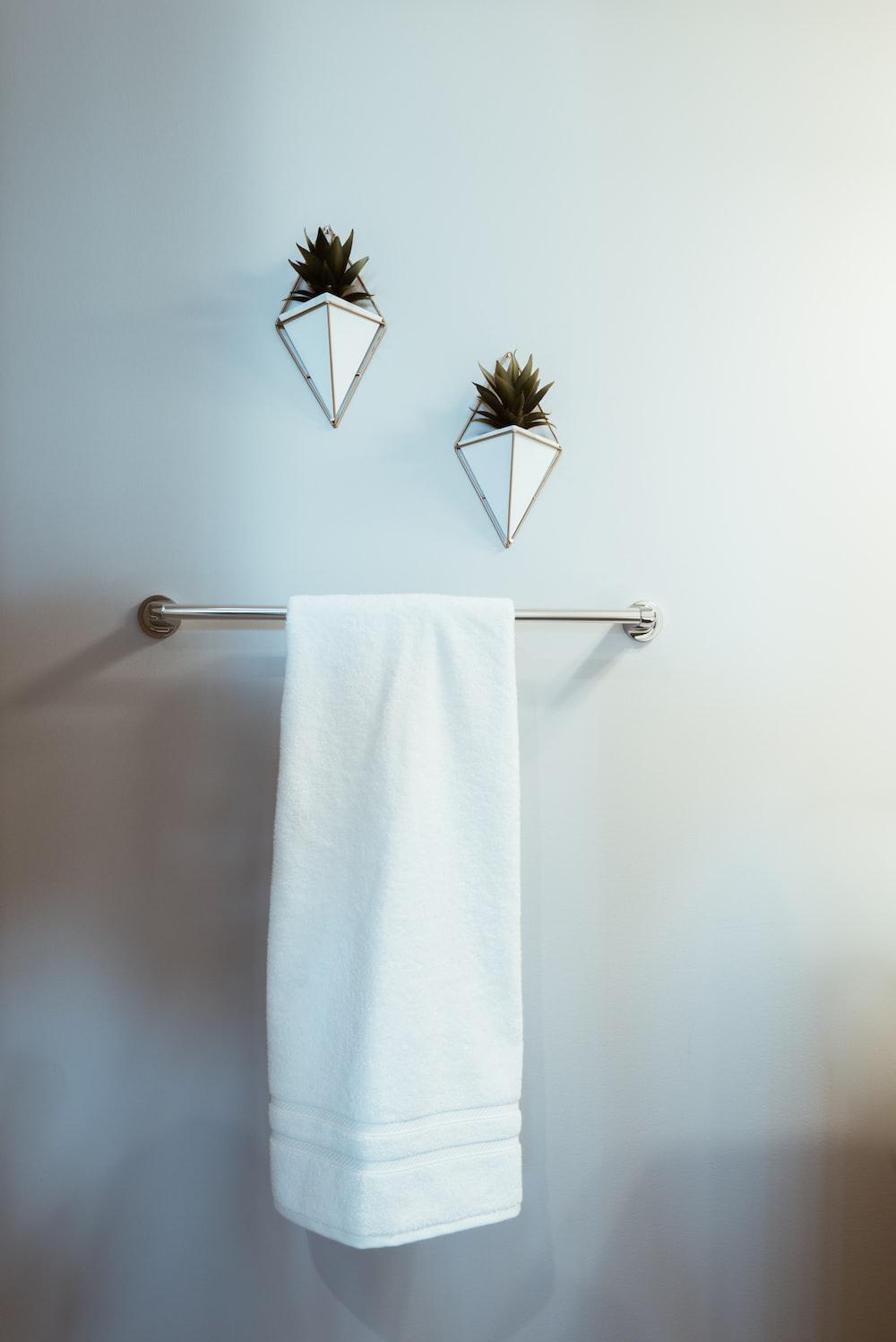 white towel on stainless steel towel rack