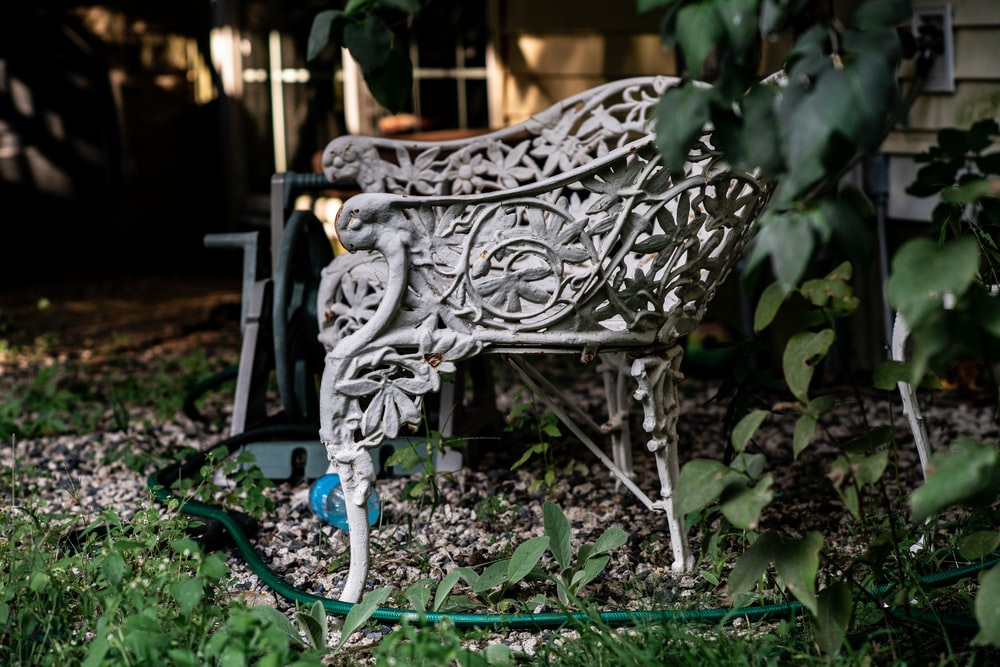 black metal armchair on green grass