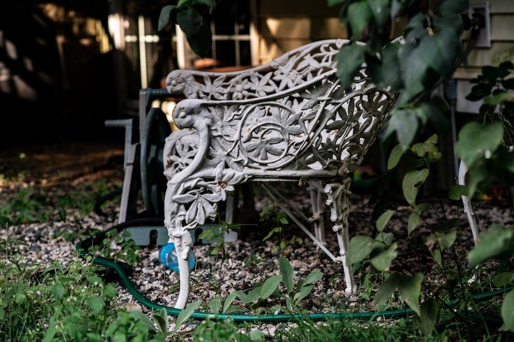 black metal armchair on green grass