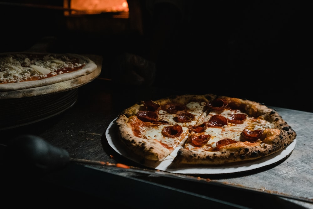 pizza on black wooden table