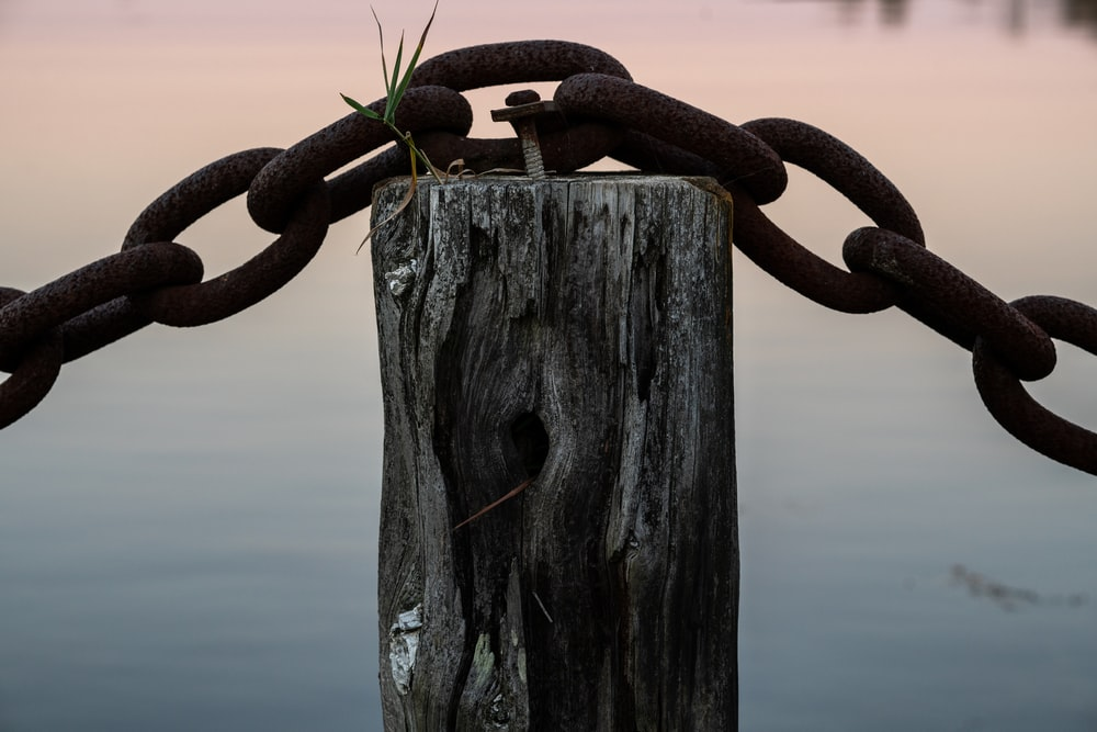 brown metal chain on brown wooden post