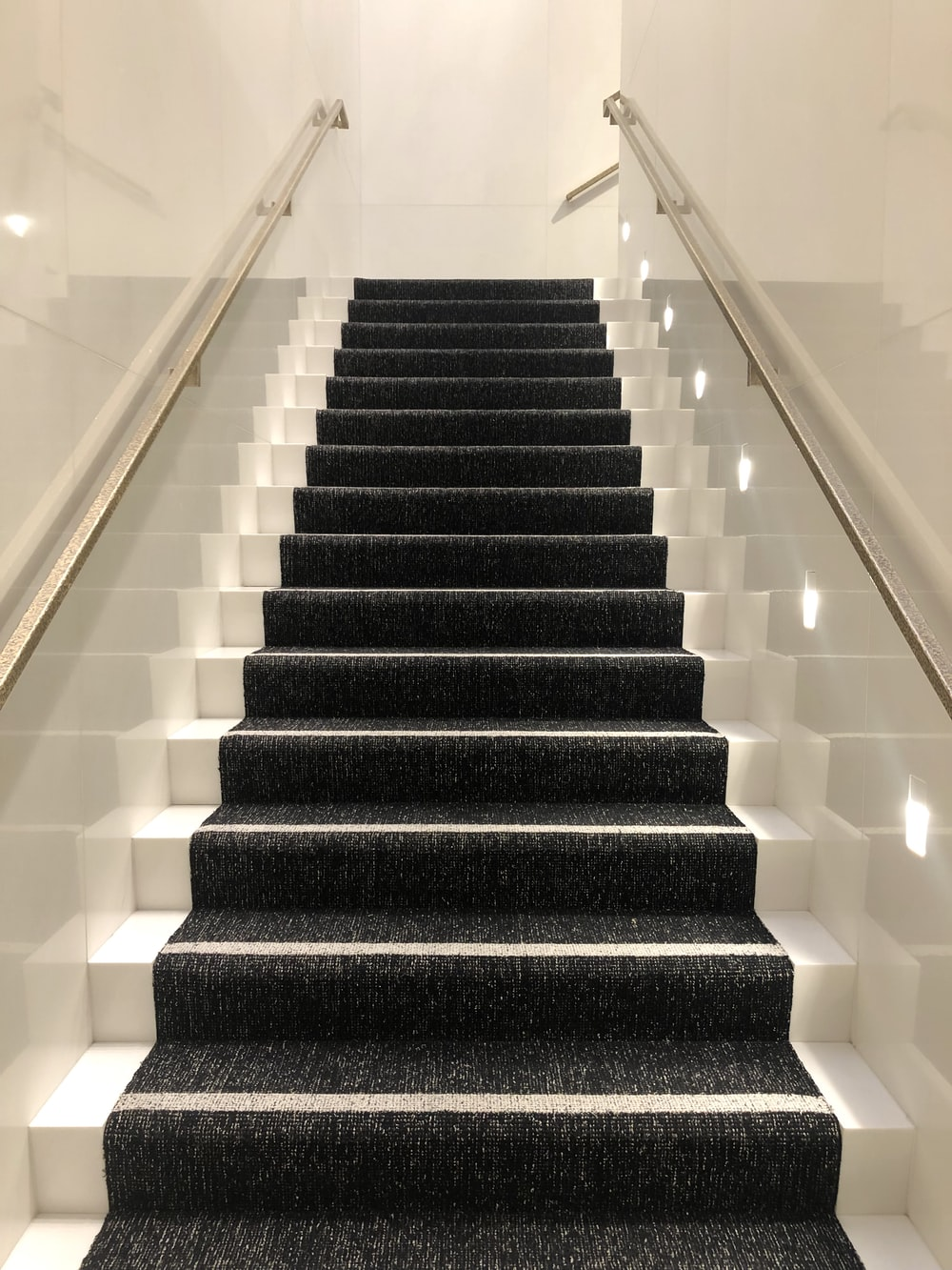 black and white staircase with white railings
