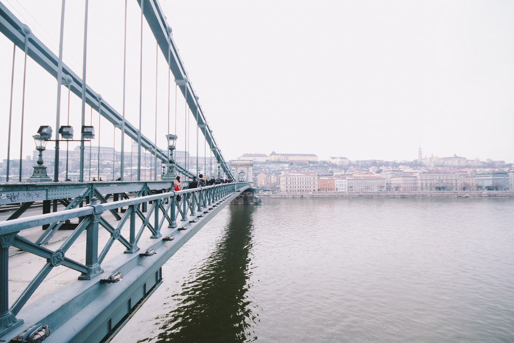 white and brown concrete bridge over river during daytime