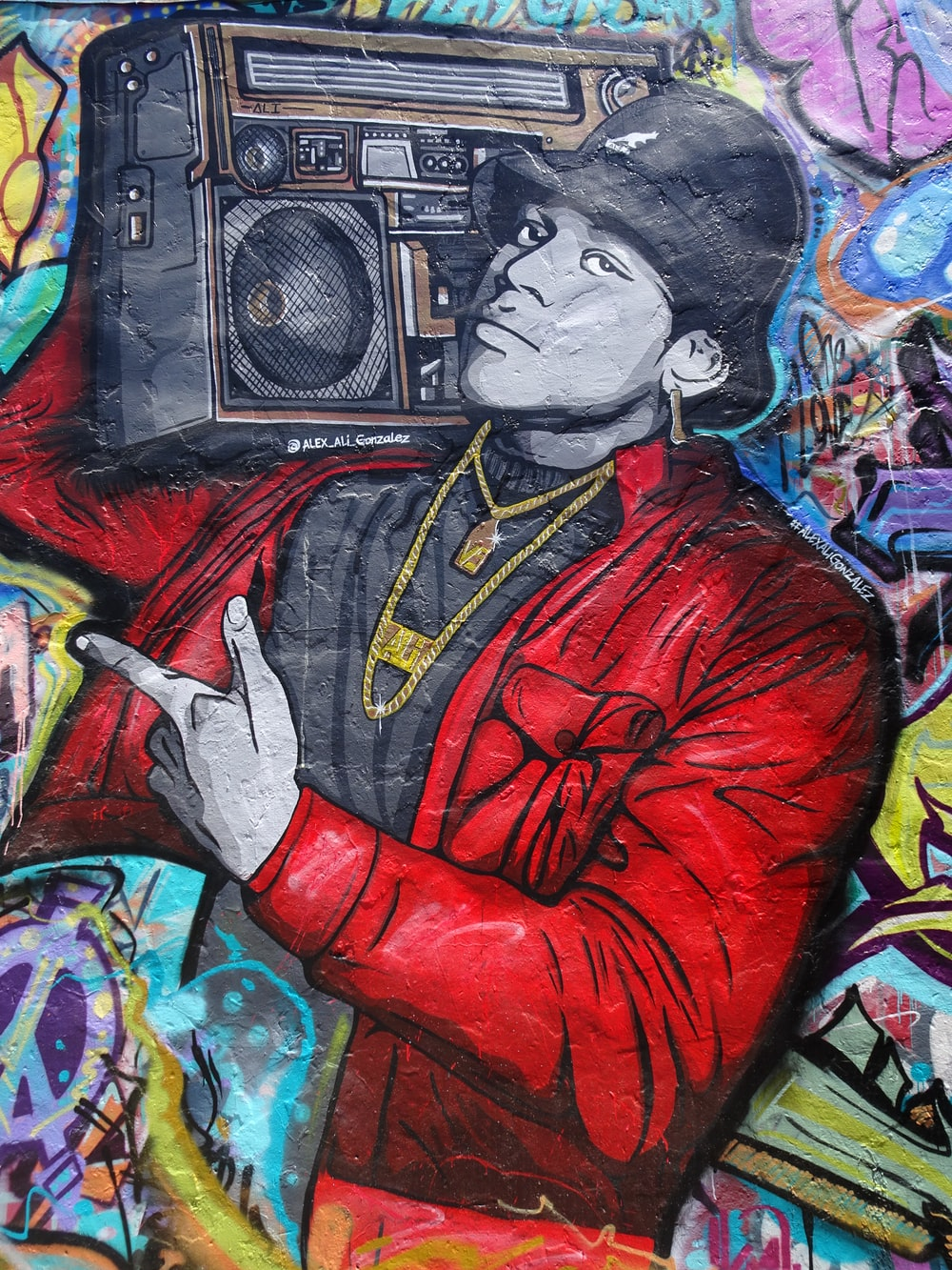 man in red leather jacket painting