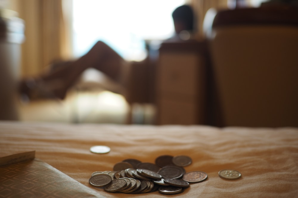 silver coins on brown wooden table