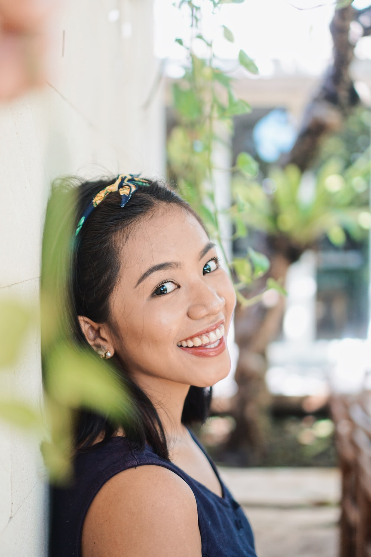 smiling woman in black shirt
