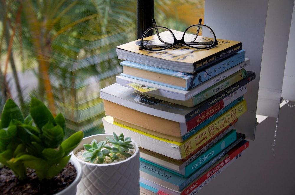 black framed eyeglasses on books