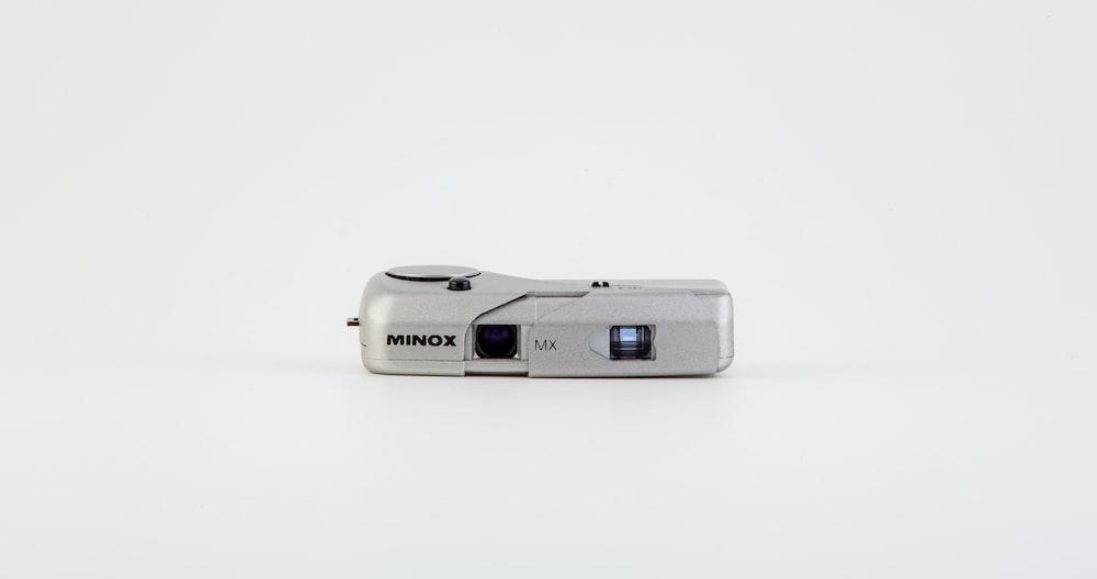 white and gray sony camera
