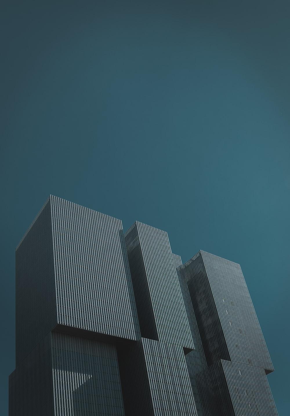 black concrete building under blue sky
