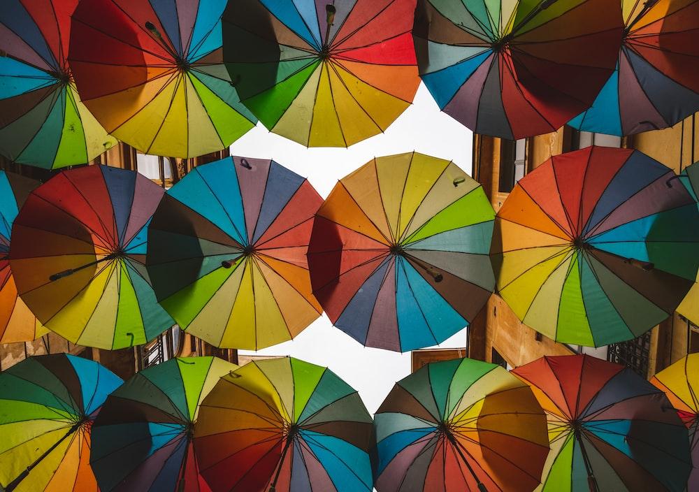 multi colored umbrella under sunny sky