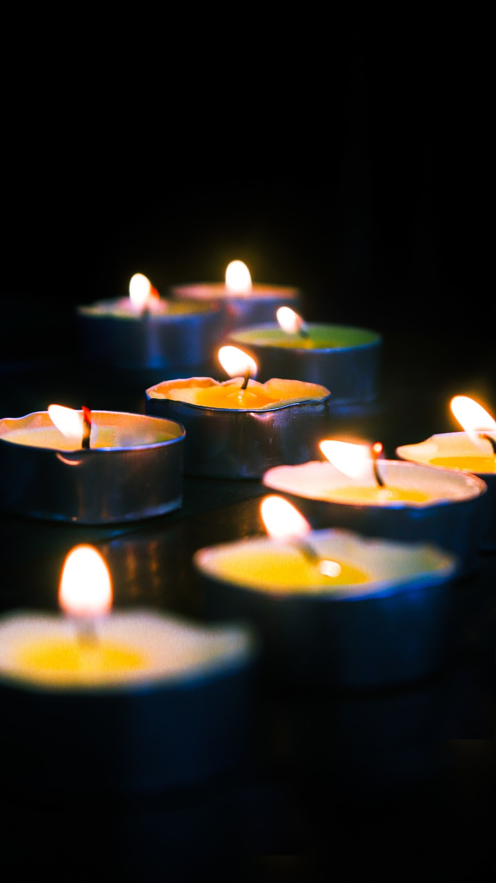 blue candles on black surface