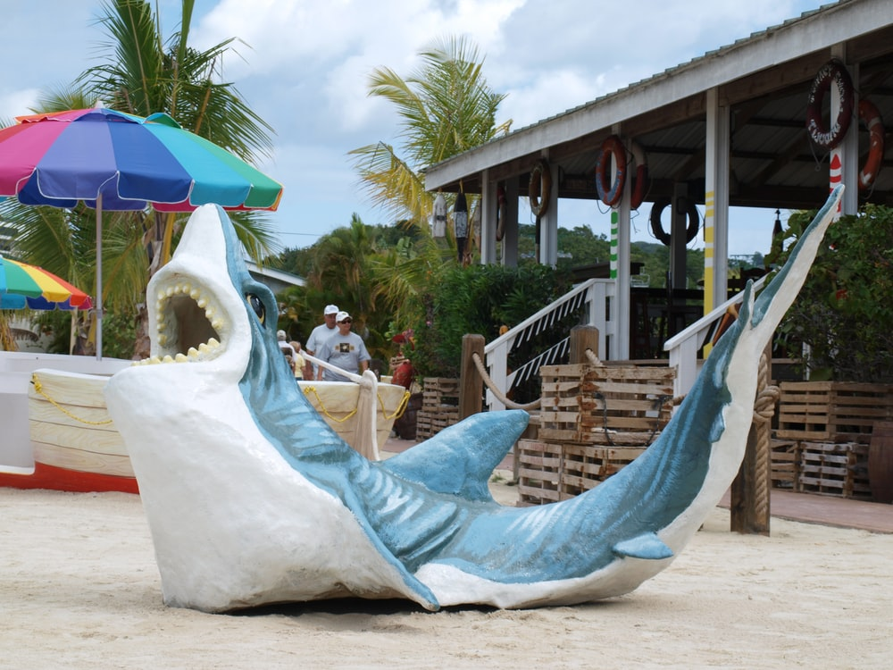 white and blue beach lounge chair on beach during daytime