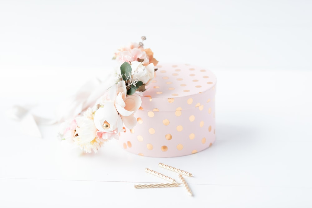 white and pink polka dot gift box with pink and white roses