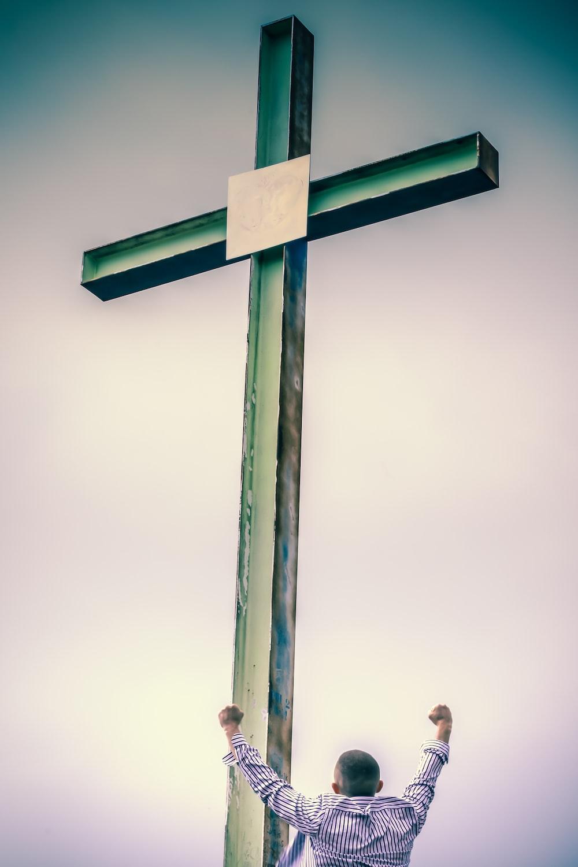 brown wooden cross with cross